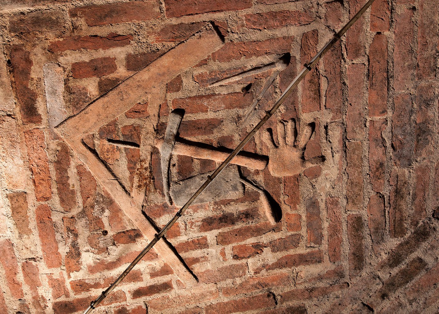 The antique symbols one can see on the walls of the cellar.